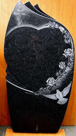 фото Свеча, голубь, крест и розы на граните.